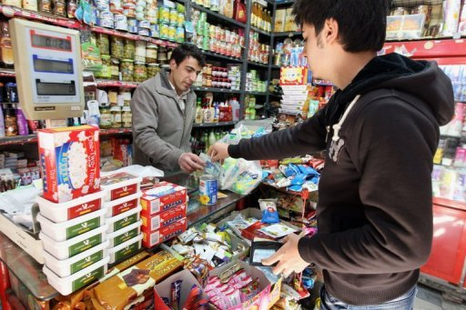 An Iranian man shops in a grocery in Tehran in 2010. Young Tehranis' struggle to stay in Iran's middle class is becoming increasingly more difficult because of the country's economic straits made much worse by EU and US sanctions