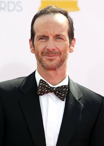 Denis O'Hare arrives at the 64th Primetime Emmy Awards at the Nokia Theatre on Sunday, Sept. 23, 2012, in Los Angeles. (Photo by Matt Sayles/Invision/AP)