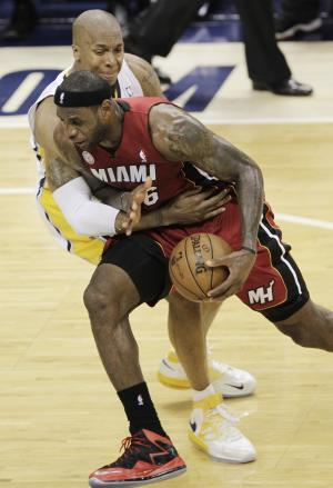 Miami Heat forward LeBron James gets fouled by Indiana Pacers forward David West during the second half of Game 6 of the NBA Eastern Conference basketball finals in Indianapolis, Saturday, June 1, 2013. (AP Photo/AJ Mast)