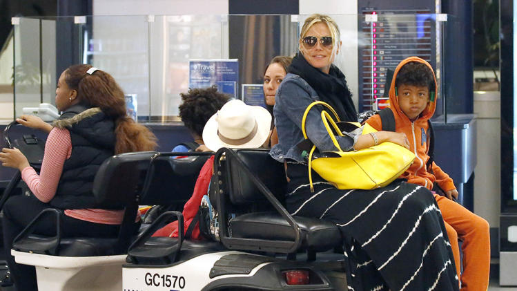 Heidi Klum, Martin Kristen and the rest of the family are spotted arriving and getting the VIP treatment back in Los Angeles as they take the little buggy cart through LAX
