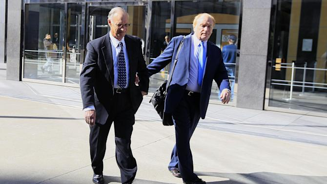 Robert Maegerle, left, walks out of a federal courthouse with attorney Jerome Froelich Jr. in San Francisco, Thursday, March 8, 2012. Maegerle, a retired DuPont engineered accused of working with Walter Liew to illegally sell DuPont's techonology to a company controlled by the Chinese government, pleaded not guilty to economic espionage charges. (AP Photo/Jeff Chiu)