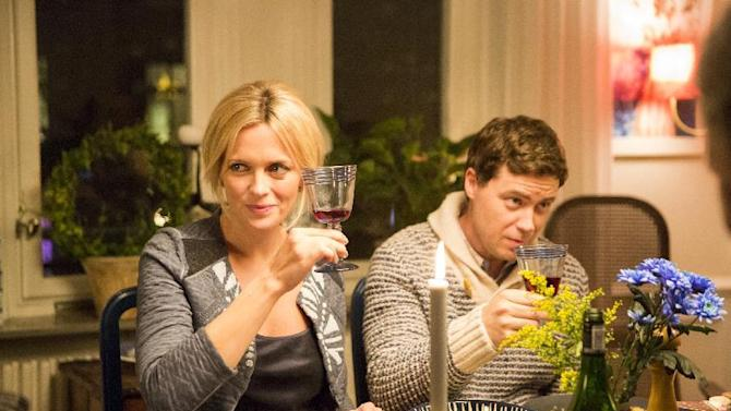 """In this image released by NBC, Josephine Bornebusch, left, and Greg Poehler appear in a scene from the NBC comedy """"Welcome to Sweden."""" NBC has canceled the comedy starring Poehler, brother of actress Amy Poehler, two weeks into its second season. NBC says """"Hollywood Game Night"""" will air this Sunday in its place and they're determining when the rest of the season will play out. (Alexandra Aristarhova/TV4 AB)"""