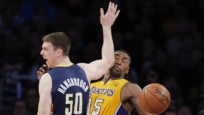 Los Angeles Lakers' Metta World Peace 915) is hit by the elbow of Indiana Pacers' Tyler Hansbrough (50) in the first half of an NBA basketball game in Los Angeles, Tuesday, Nov. 27, 2012. (AP Photo/Jae C. Hong)