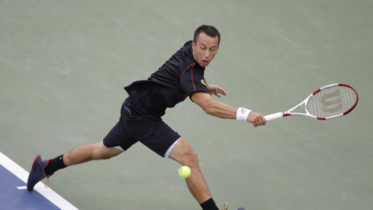 Philipp Kohlschreiber, of Germany, returns a shot against John Isner, of the United States, during the third round of the 2014 U.S. Open tennis tournament, Saturday, Aug. 30, 2014, in New York. (AP Photo/Darron Cummings)