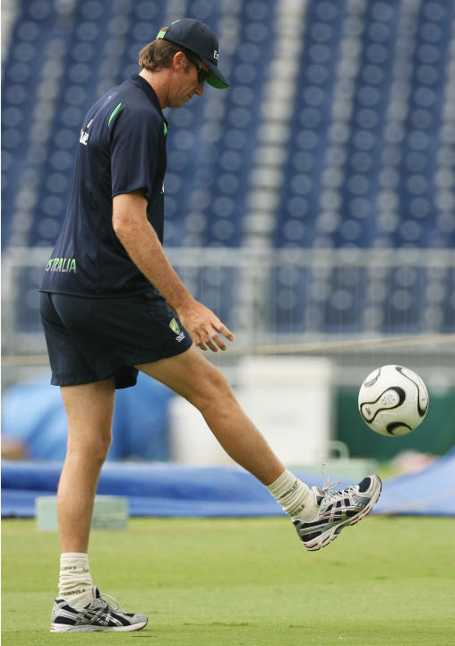 BRIDGETOWN, BARBADOS - APRIL 27:  Glenn McGrath of Australia kicks a football during an Australia team training session at the Kensington Oval on April 27, 2007 in Bridgetown, Barbados.  (Photo by Ham