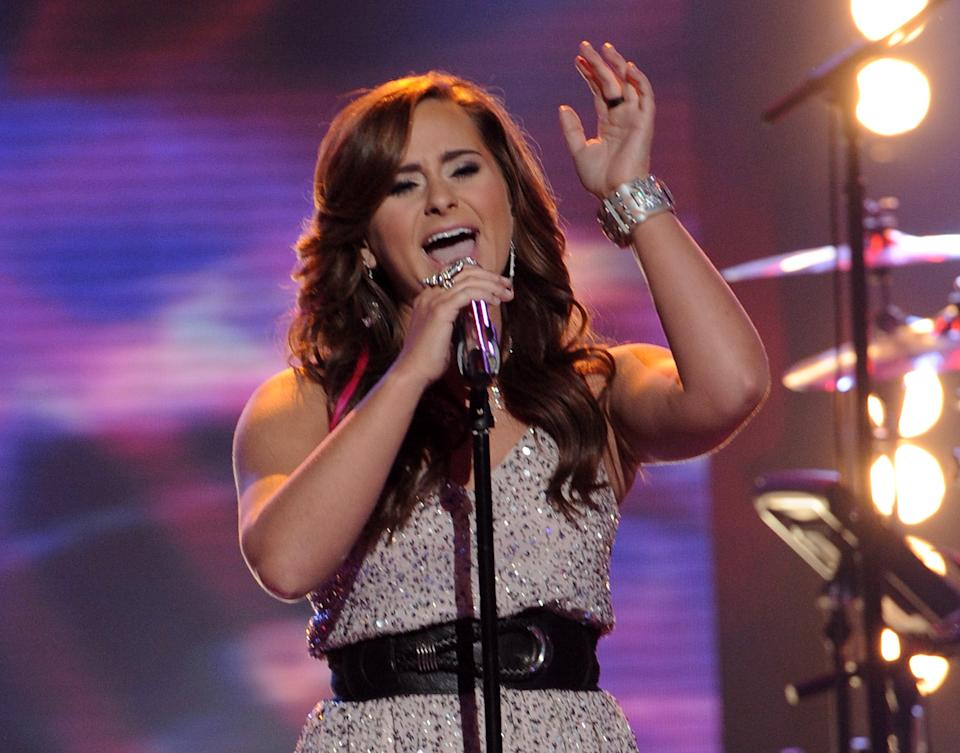 "In this April 25, 2012 photo released by Fox, contestant Skylar Laine performs on the singing competition series ""American Idol,"" in Los Angeles. (AP Photo/Fox, Michael Becker)"