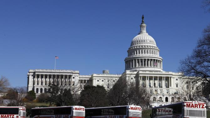 FILE - In this March 23, 2009 file photo, tour buses line up in front of the U.S. Capitol in Washington. Whether visitors want to try one of the first family's favorite restaurants, discover a sense of history or escape from the crowd to find a museum off the beaten path, Washington is the nation's cultural capital this weekend for inauguration visitors. (AP Photo/Jacquelyn Martin, File)