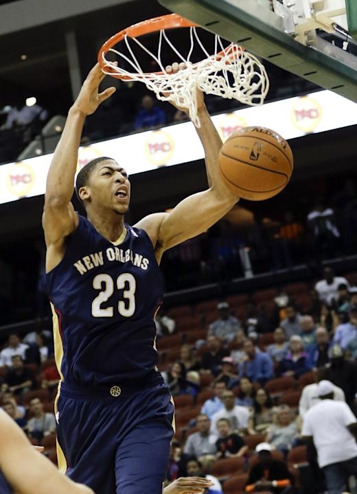 New Orleans Pelicans' Anthony Davis (23) dunks the ball against the Orlando Magic during the first half of an NBA preseason basketball game in Jacksonville, Fla., Wednesday, Oct. 9, 2013