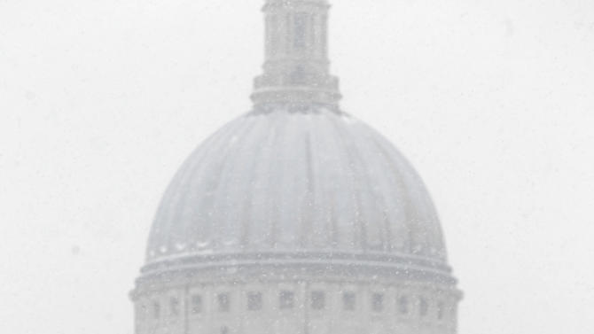 """FILE - This Jan. 18, 2013 file photo shows people walking across a snowy Millennium Bridge near St. Paul's Cathedral in London. For visitors on a literary tour of London, the view of the city from the top of the cathedral was shown by David Copperfield to Clara Peggoty in Charles Dickens' """"David Copperfield.""""  (AP Photo/Sang Tan, file)"""