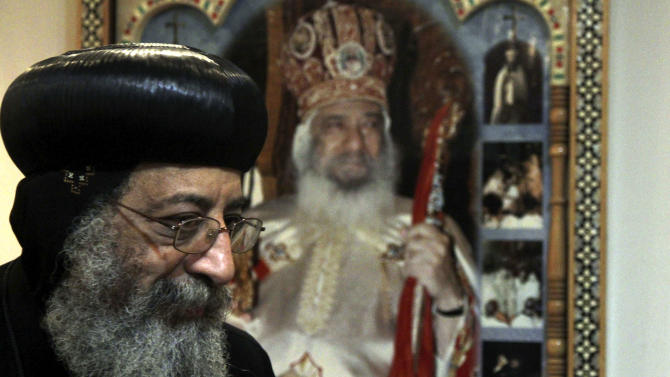 Bishop Tawadros, 60, soon to be Pope Tawadros II  greets well-wishers, not shown, after being named the 118th Coptic Pope in the Wadi Natrun Monastery complex northwest of Cairo, Egypt, Sunday, Nov. 4, 2012. Egypt's ancient Coptic Christian church named a new pope on Sunday, Nov. 4, 2012 to spiritually guide the community through a time when many fear for their future with the rise of Islamists to power and deterioration in police powers after last year's uprising. (AP Photo/Roger Anis, El Shorouk Newspaper) EGYPT OUT