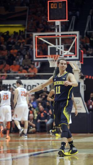 Michigan guard Nik Stauskas (11) struts after sinking a 3-point shot to end the first half of an NCAA college basketball game against Illinois on Tuesday, March 4, 2014, in Champaign, Ill. (AP Photo/Rick Danzl)