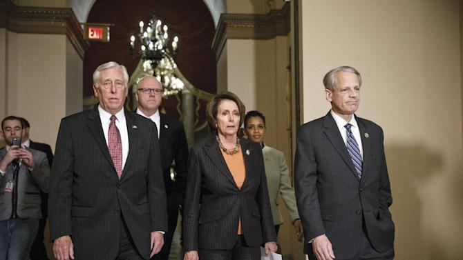 House Democratic leaders, from left, Minority Whip Steny Hoyer, D-Md., Rep. Joe Crowley, D-N.Y., House Minority Leader Nancy Pelosi, D-Calif., Rep. Donna Edwards, D-Md., and Rep. Steve Israel, D-N.Y., meet with reporters  as Congress passes a one-week bill to avert a partial shutdown of the Homeland Security Department, as leaders in both political parties quelled a revolt by House conservatives furious that the measure left President Barack Obama's immigration policy intact, late Friday, Feb. 27, 2015, at the Capitol in Washington. (AP Photo/J. Scott Applewhite)