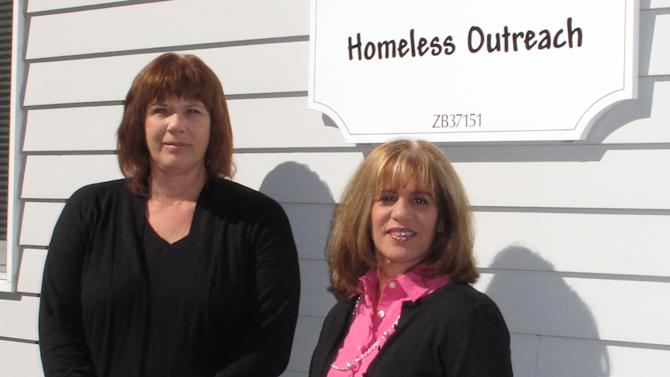 In this Oct. 11, 2012 photo, Tracey Lutz, left, executive director of the Maureen's Haven homeless outreach program, and Joann Piche, chairwoman of the board of directors, stand outside the Long Island charity's headquarters in Riverhead, N.Y. In one of the richest communities on the tony end of Long Island, a group of churches work together to provide shelter for 50-60 homeless people each night. While many have jobs, they can't afford a place to stay and don't want to leave the area where they were born and bred. (AP Photo/Frank Eltman)