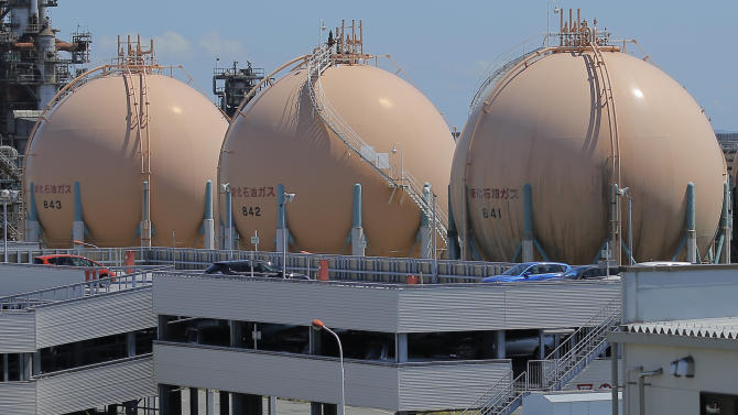 Liquefied petroleum gas storage tanks are seen at an industrial area in Yokohama in Kanagawa prefecture, south of Tokyo, Wednesday, Aug. 22, 2012.  Japan slipped back into a trade deficit in July, as exports languished and imports of gas and generating equipment surged, the Ministry of Finance reported Wednesday. (AP Photo/Itsuo Inouye)