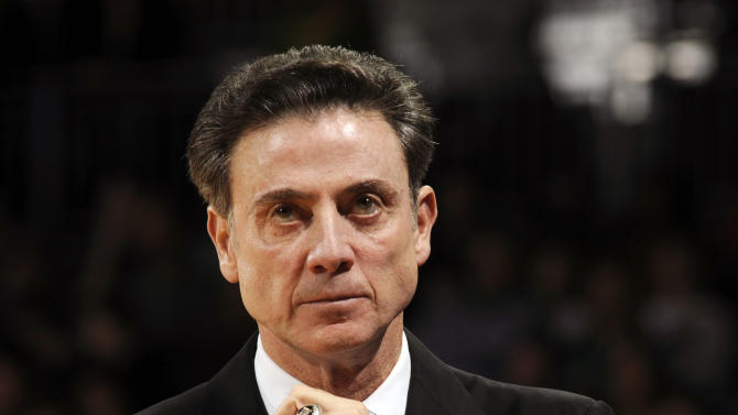 Louisville coach Rick Pitino watches his team during the first half of an NCAA college basketball game with Notre Dame Saturday, Feb. 9, 2013 in South Bend, Ind. (AP Photo/Joe Raymond)