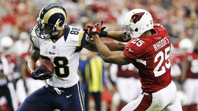 St. Louis Rams' Lance Kendricks (88) fends off Arizona Cardinals' Kerry Rhodes (25) for a touchdown during the first half in an NFL football game, Sunday, Nov. 25, 2012, in Glendale, Ariz. (AP Photo/Ross D. Franklin)