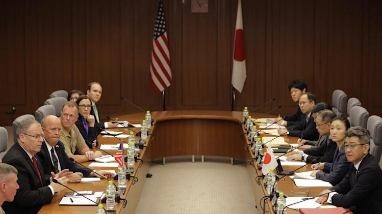 U.S. Deputy Secretary of Defense Robert Work, 2nd left, and Japanese counterpart Ryota Takeda, right, attend a meeting at Defense Ministry in Tokyo Friday, Aug. 22, 2014. (AP Photo/Eugene Hoshiko)