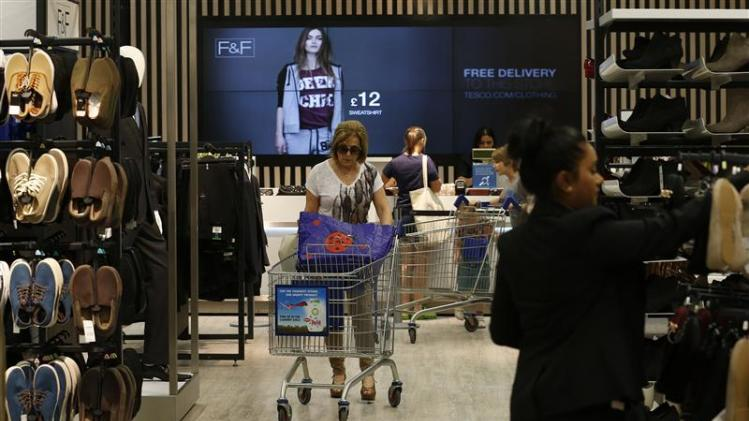 Customers shop in the F&F clothing department at a Tesco Extra supermarket in Watford, north of London