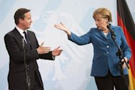 German Chancellor Angela Merkel and British Prime Minister David Cameron address a press conference at the chancellery in Berlin on June 7. The two leaders agreed that closer fiscal discipline in the European Union alone was not enough to stem more than two years of turbulence as the clock ticks down for Europe to help stabilise Spain's banking system