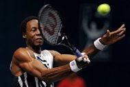 Gael Monfils of France plays a shot against Kevin Anderson of South Africa during their men's singles first round match at the ATP PTT Thailand Open tennis tournament in Bangkok. Monfils is targeting a return to the world's top 10 after injury, he said Wednesday