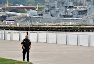 A police officer patrols outside the US Navy Yard September 16, 2013 in Washington, DC