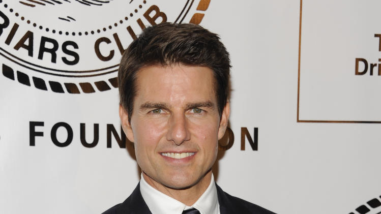 Actor Tom Cruise poses after being honored by The Friars Club and Friars Foundation at The Waldorf-Astoria on Tuesday June 12, 2012, in New York. (Photo by Evan Agostini/Invision/AP)