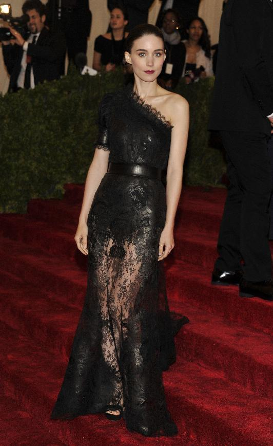 Rooney Mara arrives at the Metropolitan Museum of Art Costume Institute gala benefit, celebrating Elsa Schiaparelli and Miuccia Prada, Monday, May 7, 2012 in New York. (AP Photo/Charles Sykes)