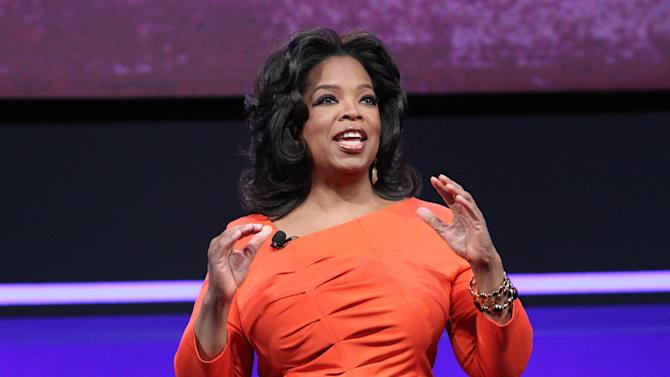 FILE - In this April 14, 2011 publicity image originally released by OWN, TV personality and media mogul Oprah Winfrey presents at the OWN: Oprah Winfrey Network portion of the Discovery Communications Upfront at Jazz at Lincoln Center in New York.  Oprah Winfrey's struggling network, OWN, is laying off 30 workers and restructuring its operations in New York and Los Angeles. (AP Photo/OWN, George Burns)  MANDATORY CREDIT: GEORGE BURNS/OWN