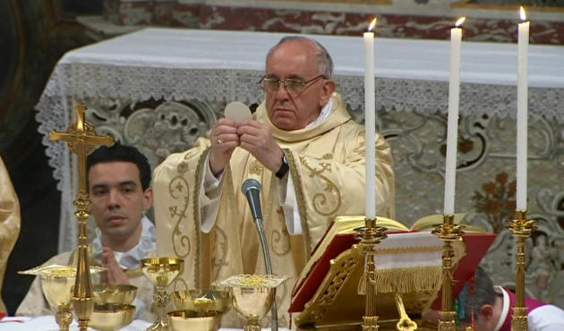 In this image made from video provided by CTV, Pope Francis, right, celebrates his inaugural Mass with cardinals inside the Sistine Chapel, at the Vatican, Thursday, March 14, 2013. As the 266th pope,
