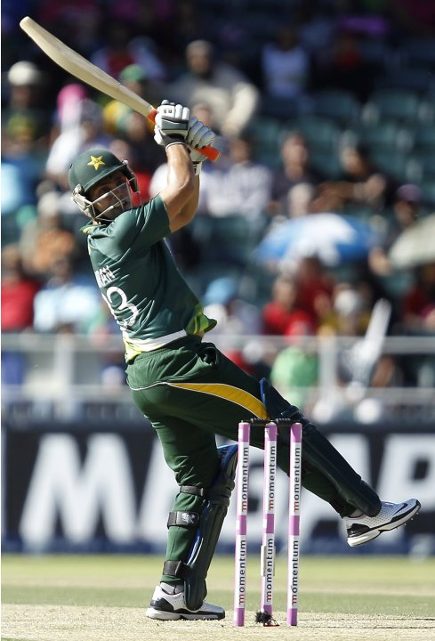 Pakistan's Akmal Kamran watches South Africa's Ryan McLare's delivery during their third One Day International (ODI) cricket match in Johannesburg