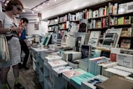 People browse books in a bookstore of Hong Kong. Chinese fiction also tends to follow a template, according to a Hong Kong based British publisher, ignoring the realities of industrialised, modern China, which continues to grow and change at a bewildering pace