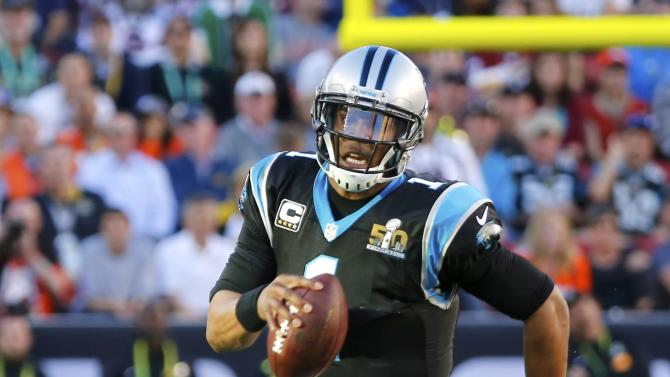 Carolina Panthers' quarterback Cam Newton runs with the ball during the second quarter of the NFL's Super Bowl 50 football game against the Denver Broncos in Santa Clara
