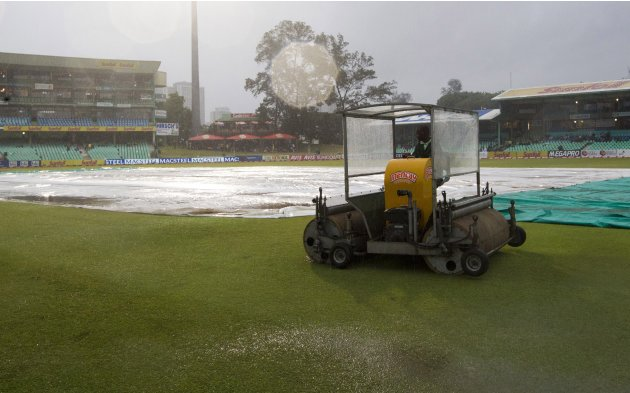 Ground staff attempt to dry out the ground with a super sopper in Durban