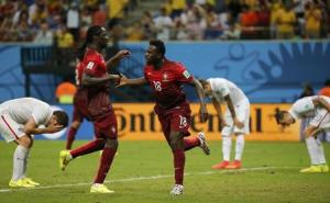 Portugal's Varela celebrates with his teammate Eder after scoring a goal against the U.S. during their 2014 World Cup Group G soccer match at the Amazonia arena in Manaus