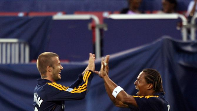 EAST RUTHERFORD, NJ - AUGUST 18: David Beckham #23 of the Los Angeles Galaxy celebrates with Carlos Pavon #20 after their first goal against the New York Red Bulls at Giants Stadium on August 18, 2007 in East Rutherford, New Jersey. (Photo by Mike Ehrmann/Getty Images for Red Bulls)