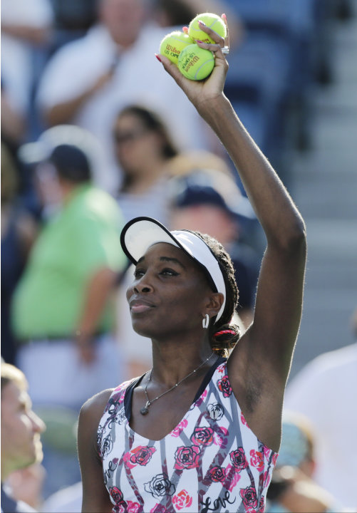 Venus Williams waves to the crowd after winning her match against Bethanie Mattek-Sands during the first round of play at the 2012 US Open tennis tournament, Tuesday, Aug. 28, 2012, in New York. (AP P