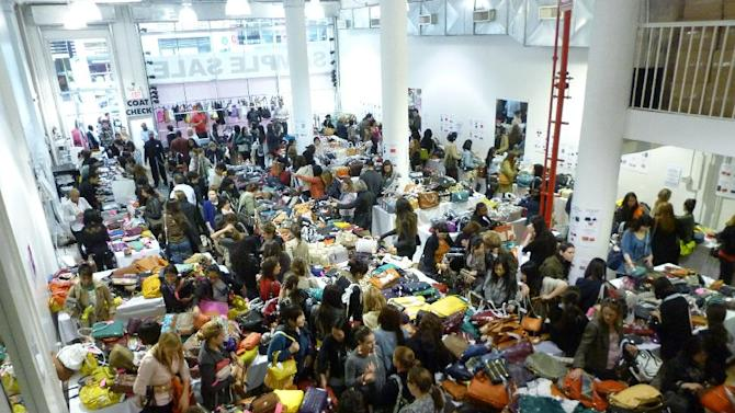 This 2012 photo provided by 260SampleSale shows shoppers looking through designer merchandise at a sample sale at the company's 260 Fifth Avenue showroom in New York. Sample sales offer leftover designer goods at deep discounts and are sold at a variety of venues around the city, including showrooms like this one. 260SampleSale partners with various designers throughout the year. (AP Photo/ 260SampleSale)