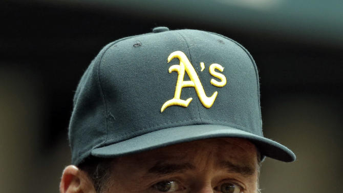 FILE - This Aug. 25, 2012 file photo shows Oakland Athletics manager Bob Melvin during a baseball game against the Tampa Bay Rays in St. Petersburg, Fla. Melvin has received a two-year contract extension through the 2016 season after leading Oakland to a surprising AL West title last year. The A's announced Monday, Jan. 14, 2013,  that Melvin, the reigning AL Manager of the Year, received a new deal. (AP Photo/Chris O'Meara, File)
