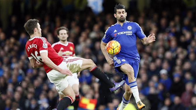 Chelsea's Diego Costa in action with Manchester United's Michael Carrick