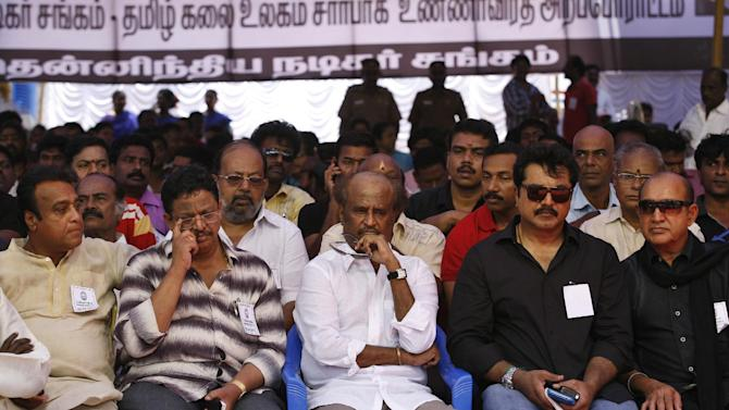 Indian Tamil movie stars, including superstar Rajnikanth, center, sit during a day long fast in Chennai, India, Tuesday, April 2, 2013 demanding probe into alleged wartime abuses by Sri Lanka. The stars are fasting for a day to protest what they say is the mistreatment of ethnic Tamils in neighboring Sri Lanka and to demand an international probe into alleged wartime abuses there. A U.N. investigation into the final months of the war indicated that the ethnic Sinhalese-dominated government might have killed as many as 40,000 Tamil civilians. (AP Photo/Arun Sankar K)