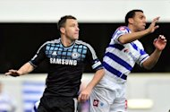 John Terry (L) and Queens Park Rangers' Anton Ferdinand during an FA Cup match in January. Terry dramatically quit international football fewer than 24 hours before an FA hearing into allegations he racially abused Ferdinand