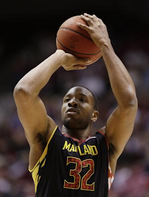 FILE - In this March 26, 2013 file photo, Maryland's Dez Wells shoots a free throw during the first half of an NIT tournament basketball game against Alabama in Tuscaloosa, Ala. Wells, a former Xavier University basketball player, is suing the school, alleging it damaged his reputation by expelling him for what he says was a false sexual assault accusation. (AP Photo/Dave Martin, File)