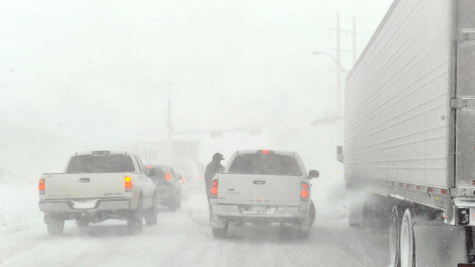 Traffic moves on the I-40 service road Monday, Feb. 25, 2013. A blizzard packing 50 mph wind gusts and more than 11 inches of snow blasted Amarillo and Texas Panhandle Monday, Feb. 25, 2013, making travel nearly impossible. Interstate 40 and many major highways in the Panhandle have been closed. (AP Photo/The Amarillo Globe News,Michael Schumacher)