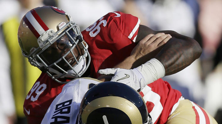 St. Louis Rams quarterback Sam Bradford (8) is sacked by San Francisco 49ers outside linebacker Aldon Smith (99) during the second quarter of an NFL football game in San Francisco, Sunday, Nov. 11, 2012. (AP Photo/Marcio Jose Sanchez)