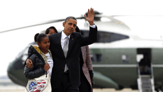 President Barack Obama, first lady Michelle Obama and their daughters Sasha, front left, and Malia, walk from Marine One to board Air Force One at Chicago O'Hare International Airport, Wednesday, Nov. 7, 2012, in Chicago, the day after the presidential election. Obama defeated Republican challenger former Massachusetts Gov. Mitt Romney. (AP Photo/Carolyn Kaster)