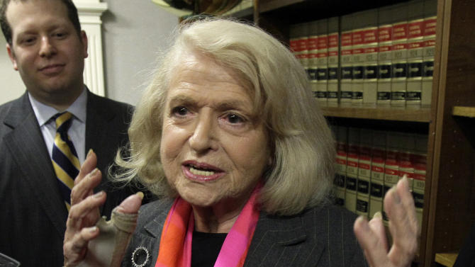 "FILE - This Oct. 18, 2012 file photo shows Edith Windsor interviewed at the offices of the New York Civil Liberties Union, in New York. Windsor sued the government in November 2010 because she was told to pay $363,053 in federal estate tax after her partner of 44 years, Thea Spyer, died in 2009. The federal Defense of Marriage Act defines marriage as ""a legal union between one man and one woman,"" and that's what the Internal Revenue Service follows when it comes to federal income taxes. AP Photo/Richard Drew, File)"
