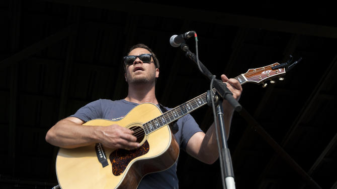 Amos Lee performs during the Bonnaroo Music and Arts Festival in Manchester, Tenn., Saturday, June 11, 2011. (AP Photo/Dave Martin)