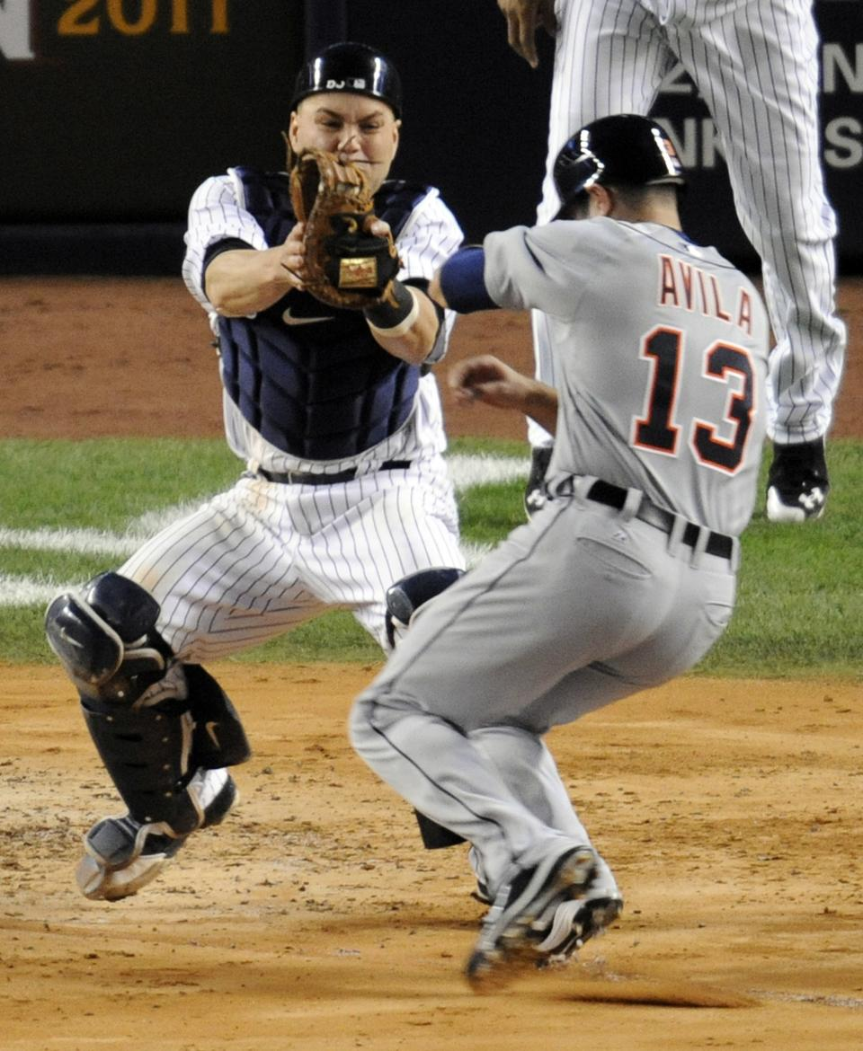 New York Yankees catcher Russell Martin, left, prepares to tag out Detroit Tigers' Alex Avila in the fifth inning during the continuation of Game 1 of baseball's American League division series Saturday, Oct. 1, 2011, at Yankee Stadium in New York. (AP Photo/Bill Kostroun)