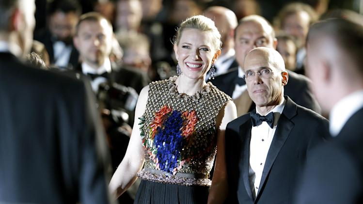 Head of Dreamworks Jeffrey Katzenberg, right, and actress Cate Blanchett leave after the screening of How To Train Your Dragon 2 at the 67th international film festival, Cannes, southern France, Friday, May 16, 2014. (AP Photo/Thibault Camus)