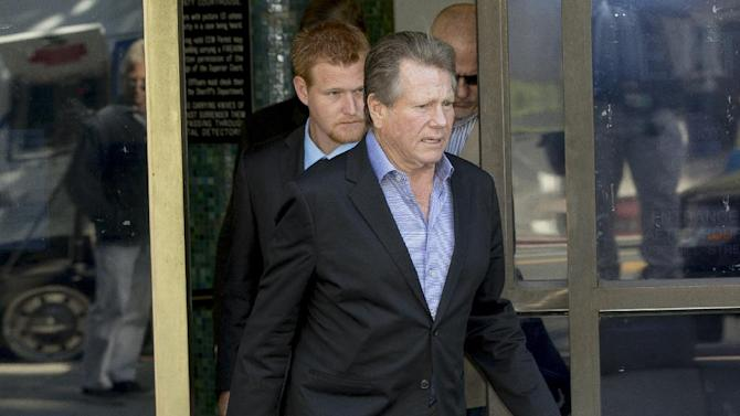 "FILE - This Dec. 12, 2013 file photo shows actor Ryan O'Neal, center, followed by his son, Redmond O'Neal, as they exit court for a lunch break in Los Angeles. A jury told a judge on Wednesday Dec. 18, 2013, that there is disagreement and seemingly a ""standstill"" in deliberations over ownership of an Andy Warhol portrait of Farrah Fawcett that is currently held by Ryan O'Neal. The University of Texas at Austin and O'Neal believe they are rightful owner of an Andy Warhol portrait of the late Farrah Fawcett. (AP Photo/Damian Dovarganes, File)"